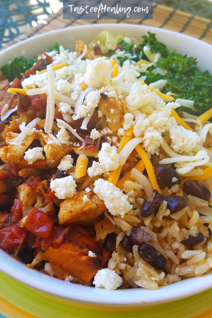 A bowl of Roasted Vegetable Tinga Burrito Bowl with Caribbean Rice and Beans