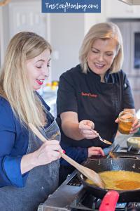 Chef Carol helping Stephanie Al-Zubaidy cook the Tangerine Olive Chicken Pailard