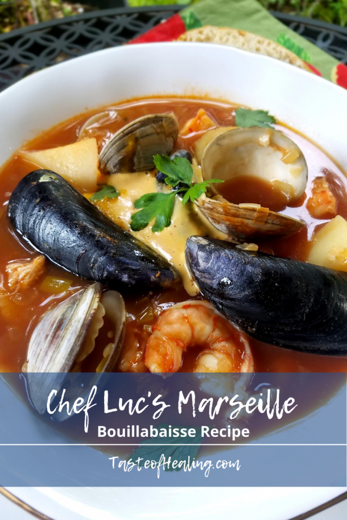 Bouillabaisse in a white bowl with Chef Luc's Marseilles Bouillabaisse Recipe in handwritten font.