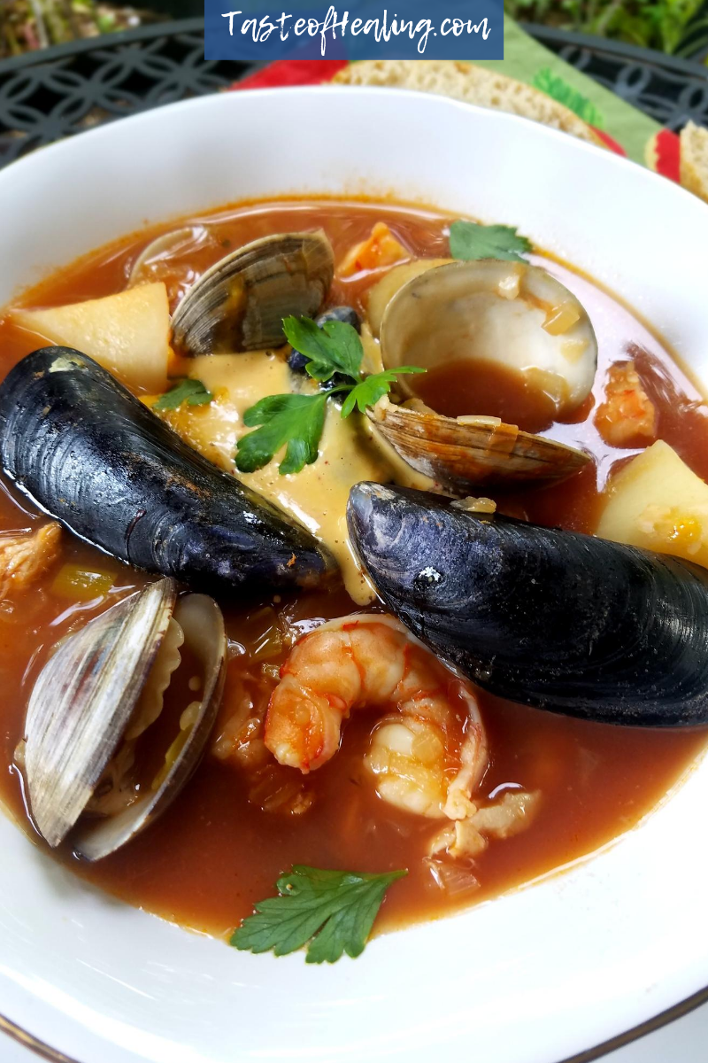 Bouillabaisse in a white bowl