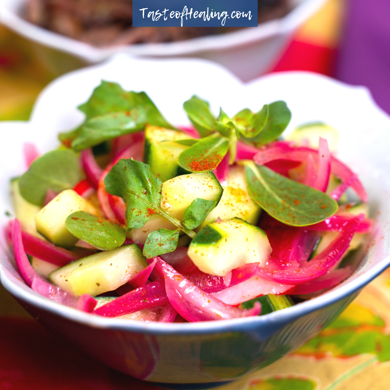 Cucumber Salad with Quick Pickled Red Onions in a blue bowl